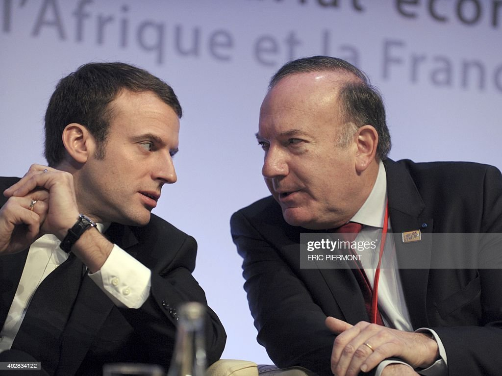 French Economy Minister Emmanuel Macron talks with the head French of the employers association Medef Pierre Gattaz during the opening of the...