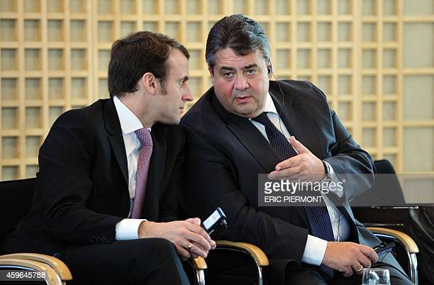 French Economy Minister Emmanuel Macron talks with with German ViceChancellor and Economy and Energy Minister Sigmar Gabriel during a bilateral...