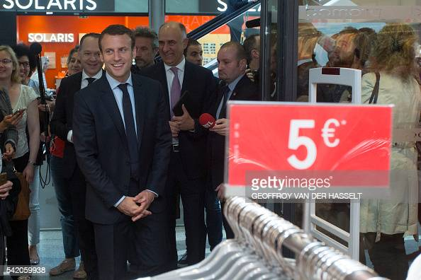 french economy minister emmanuel macron l visits the shopping center of the saint lazare. Black Bedroom Furniture Sets. Home Design Ideas