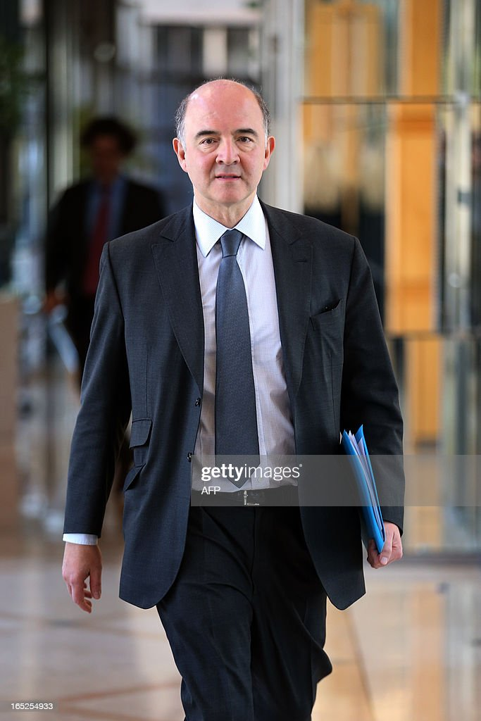 French Economy minister Pierre Moscovici arrives to take part in a ceremony marking the signing of a France-Andorra bilateral tax convention on April 2, 2013 at the ministry in Paris.