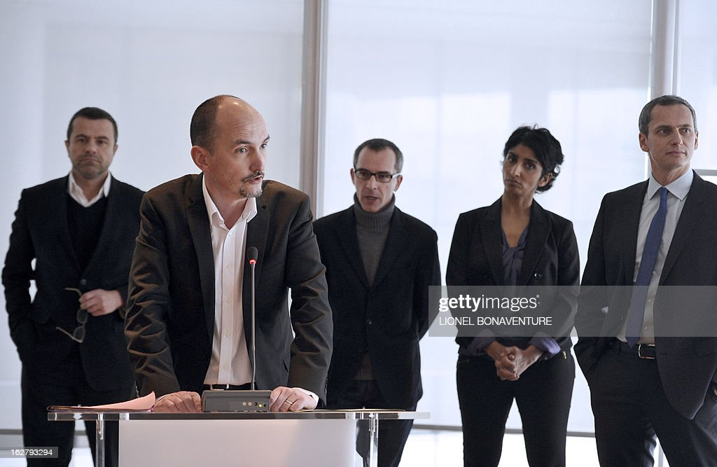 French editorial director of 'France 3' television channel of the French state-run TV group 'France Televisions', Pascal Golomer (L) addresses on February 27, 2013 at the group's headquarters in Paris during a presentation of the 'Grand Soir 3' daily evening news TV show starting from March 25. On the background are seen (from L) 'France Televisions' news director Thierry Thuillier, 'France 3' channel's director of the programs, Thierry Langlois, and French journalists and TV hosts Patricia Loison and Louis Laforge.