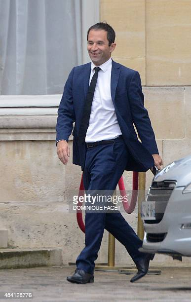 French Education minister Benoit Hamon arrives at the Hotel Matignon the French Prime minister's official residence in Paris on August 25 after the...