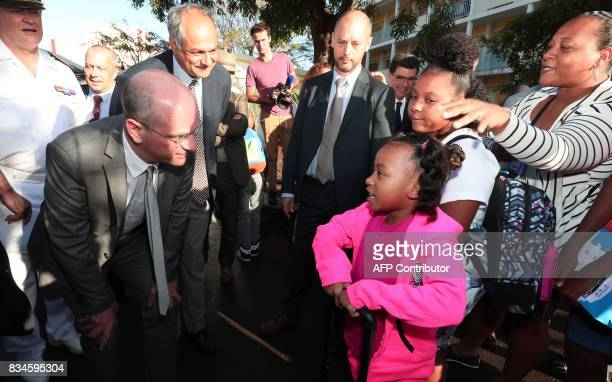 French Education Minister JeanMichel Blanquer speaks with pupils and parents as he visits the Michel Debre elementary school at the start of the new...