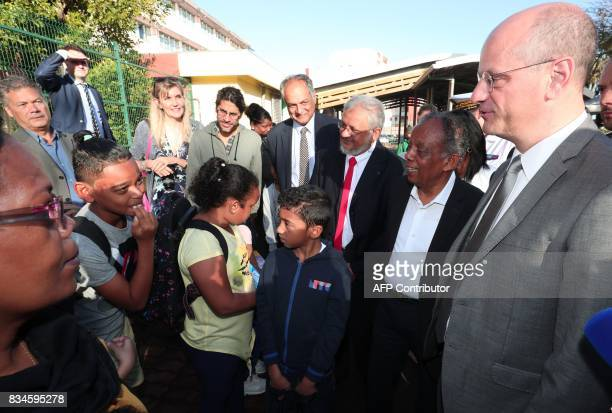 French Education Minister JeanMichel Blanquer speaks with pupils as he visits the Michel Debre elementary school at the start of the new school year...