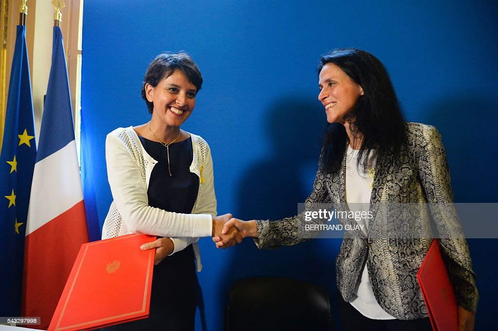 French Education minister Najat Vallaud-Belkacem (L) and Dr Chrysoula Zacharopoulou (R) shake hands after signing the first partnership convention between the Ministry of National Education, Higher Education and Research and the Info Endometriosis association in Paris, on June 27, 2016. The gynaecological disease endometriosis, a condition in which cells that usually line the uterus grow in other areas, often on the ovaries and can lead to difficulties in getting pregnant and even infertility. / AFP / BERTRAND