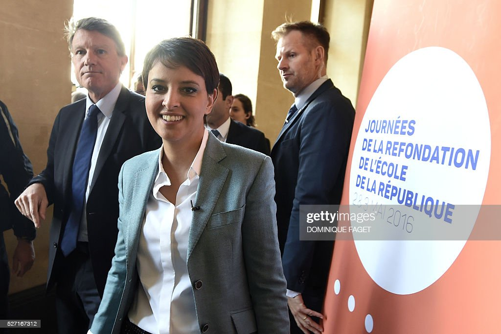 French Education Minister Najat Vallaud-Belkacem (C) and former Education Minister Vincent Peillon (L) arrive for a conference on reforming the Republican school in Paris on May 2, 2016. / AFP / DOMINIQUE