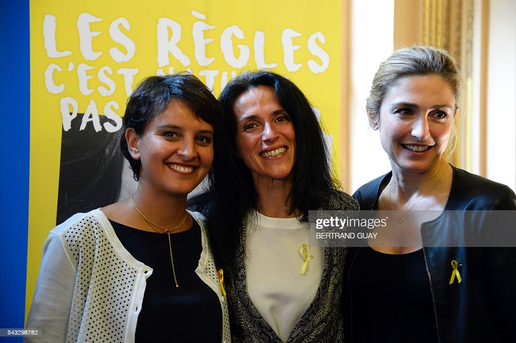 French Education Minister Najat Vallaud-Belkacem (L), Dr Chrysoula Zacharopoulou (C) and French actress Julie Gayet (R) pose after signing the first partnership convention between the Ministry of National Education, Higher Education and Research and the Info Endometriosis association in Paris, on June 27, 2016. The gynaecological disease endometriosis, a condition in which cells that usually line the uterus grow in other areas, often on the ovaries and can lead to difficulties in getting pregnant and even infertility. / AFP / BERTRAND