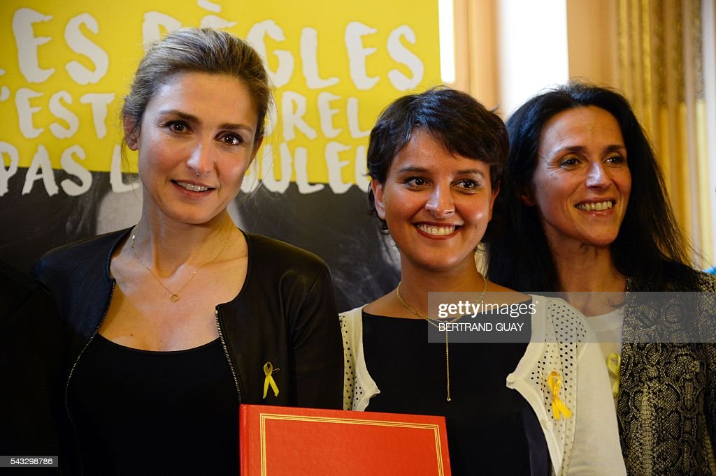 French Education Minister Najat Vallaud-Belkacem (C), Dr Chrysoula Zacharopoulou (R) and French actress Julie Gayet (L) pose after signing the first partnership convention between the Ministry of National Education, Higher Education and Research and the Info Endometriosis association in Paris, on June 27, 2016. The gynaecological disease endometriosis, a condition in which cells that usually line the uterus grow in other areas, often on the ovaries and can lead to difficulties in getting pregnant and even infertility. / AFP / BERTRAND