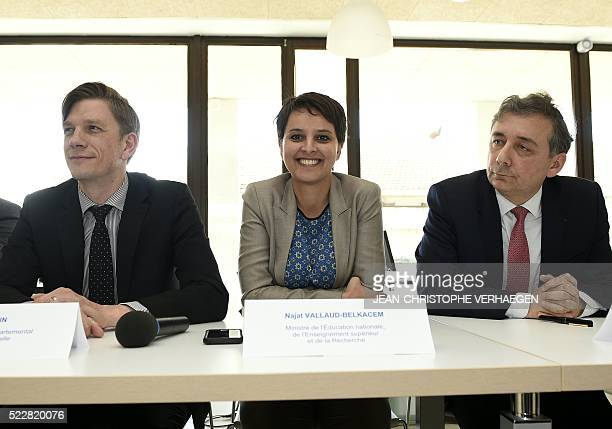 French Education minister Najat VallaudBelkacem flanked by Mathieu Klein president of MeurtheetMoselle department and Gilles Pecout rector of...