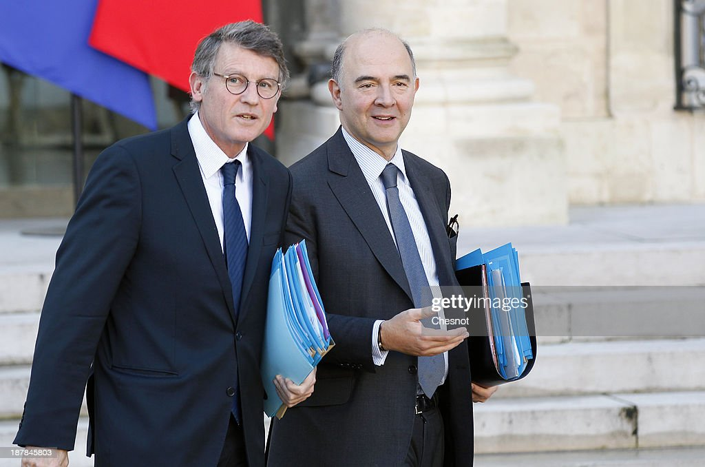 French Education Minister, <a gi-track='captionPersonalityLinkClicked' href=/galleries/search?phrase=Vincent+Peillon&family=editorial&specificpeople=2150233 ng-click='$event.stopPropagation()'>Vincent Peillon</a> (L) and French Economy, Finance and Foreign Trade Minister, <a gi-track='captionPersonalityLinkClicked' href=/galleries/search?phrase=Pierre+Moscovici&family=editorial&specificpeople=667029 ng-click='$event.stopPropagation()'>Pierre Moscovici</a> leave the Elysee Palace after the weekly cabinet meeting, on November 13, 2013, in Paris, France.The French government has opened a racism investigation after a far-right magazine cover compared the country's black justice minister to a monkey.