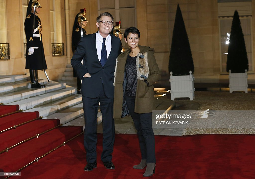 French Education Minister, Vincent Peillon (L) and French Minister for Women's Rights and Government Spokeperson, Najat Vallaud-Belkacem arrive at the Elysee palace in Paris, before a state dinner as part of a two-day state visit of Italian President Giorgio Napolitano, on November 21, 2012.
