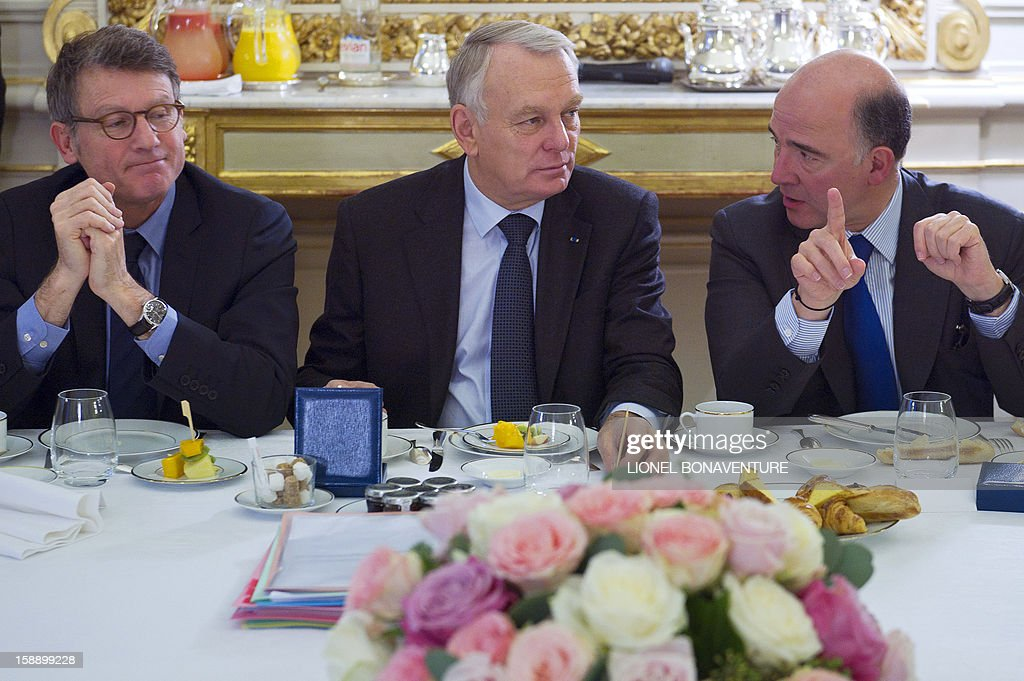 French Education Minister Vincent Peillon, French Prime Minister Jean-Marc Ayrault and French Economy, Finance and Foreign Trade Minister Pierre Moscovici speak during a breakfast gathering ministers at the Ministry of Interior, on January 3, 2013 in Paris.