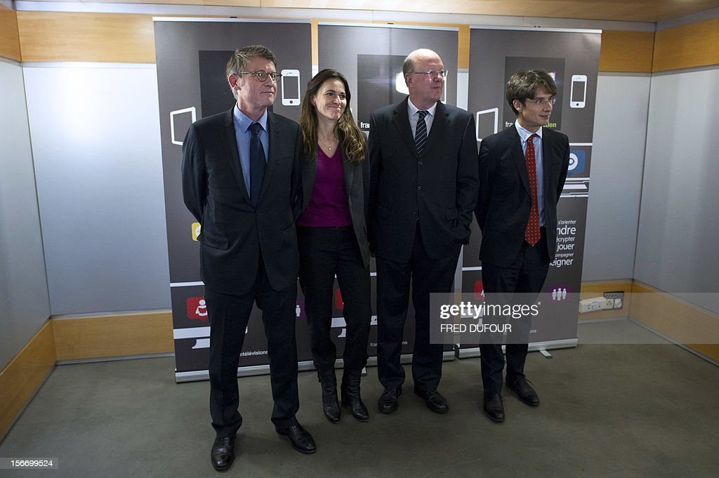 French Education Minister Vincent Peillon, Minister for Culture and Communication Aurelie Filippetti, French state owned television group France Television's director Remy Pflimlin, and director for digital development Bruno Patino, pose after a press conference to launch the group's new website 'francetveducation,' on November 19, 2012 at France Télévision headquarters in Paris.