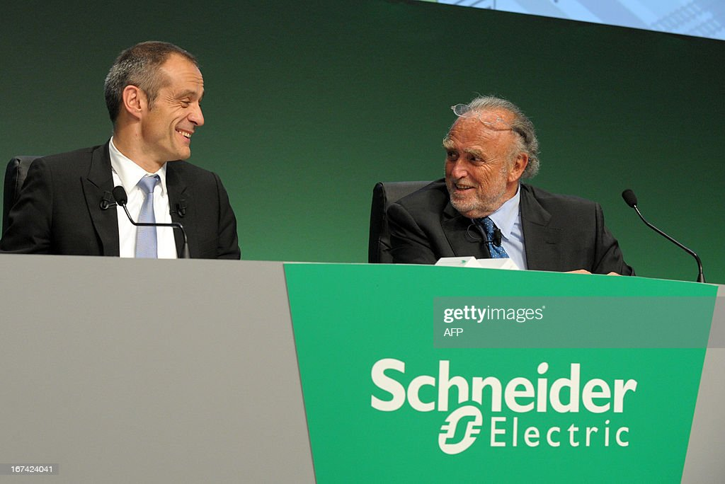 French electrical engineering giant Schneider Electric President and CEO Jean-Pascal Tricoire (L) talks with Chairman of the Supervisory Board Henri Lachmann prior to the start of the group's shareholders meeting in Paris La Defense on April 25, 2013.