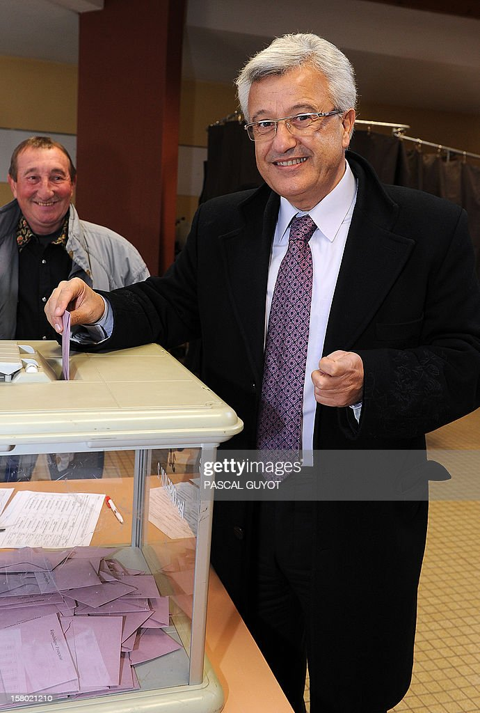 French Elie Aboud, UMP right-wing opposition party candidate for the parliamentary election in the Herault 6th constituency, casts his ballot in a polling station in Beziers, southern France, on December 9, 2012. French Conseil Constitutionnel, one of the country's highest courts, cancelled the precedent election because the socialist candidate won with 23 irregular proxy vote forms.