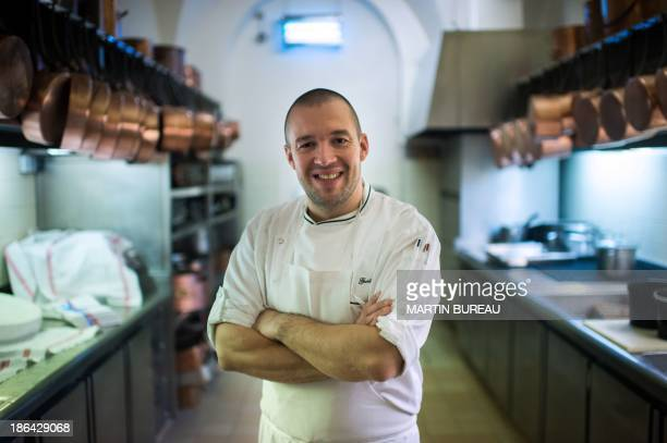 French Elysee presidential palace new chef Guillaume Gomez poses in the kitchen on October 31 2013 at the Elysee palace in Paris AFP PHOTO / POOL /...