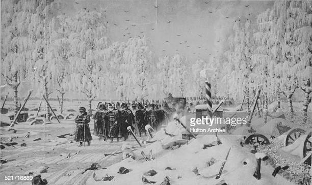 French Emperor Napoleon Bonaparte and the Grande Armee flee the pursuing Russian army in the snow on the retreat from Moscow during the Napoleonic...