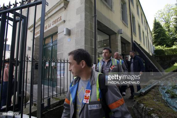 French employee of GMS car supplier under threat of closure and CGT unionists Vincent Labrousse and Yann Augras leave after a meeting with the...
