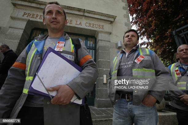 French employee of GMS car supplier under threat of closure and CGT unionists Vincent Labrousse and Yann Augras arrive to talk to the press following...