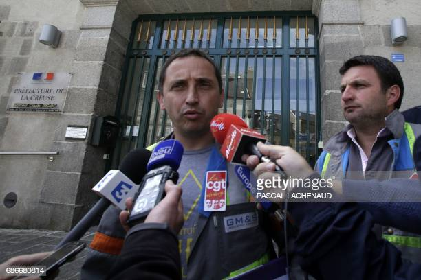 French employee of GMS car supplier under threat of closure and CGT unionists Vincent Labrousse and Yann Augras talk to the press following a meeting...