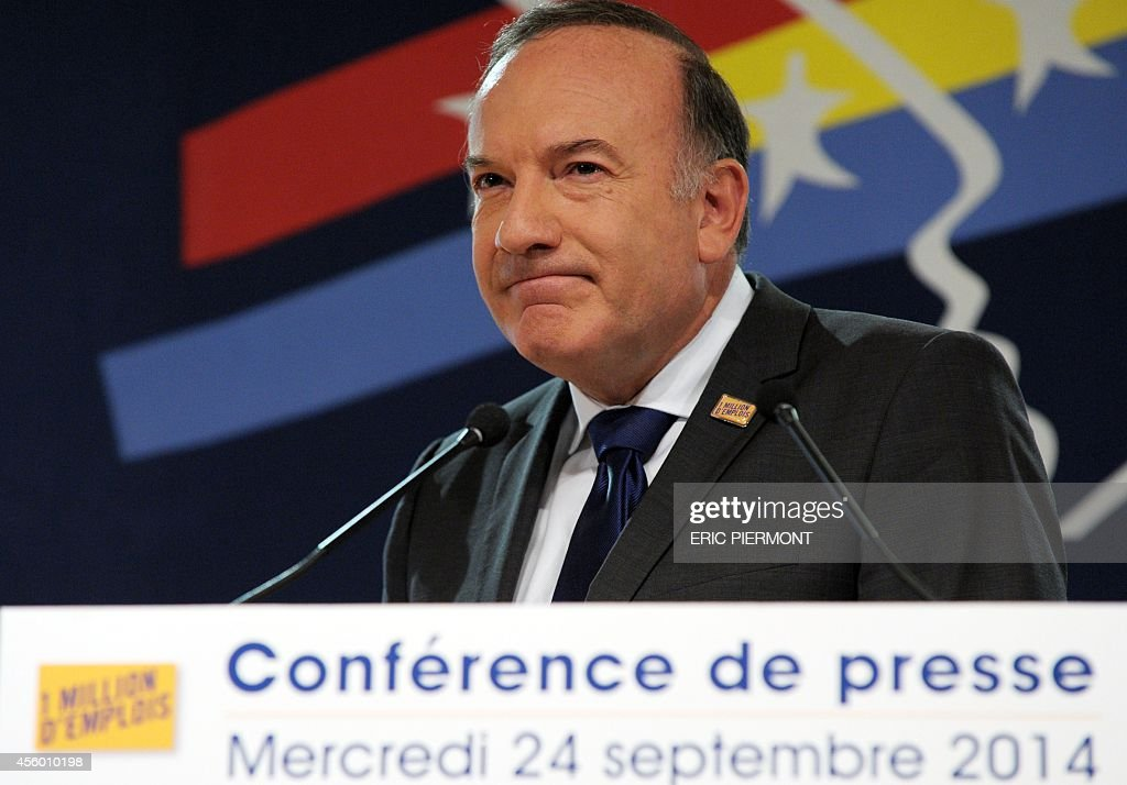French employers association Medef head Pierre Gattaz listens while presenting the Medef 'One Million Jobs' plan at the Medef headquarters in Paris...