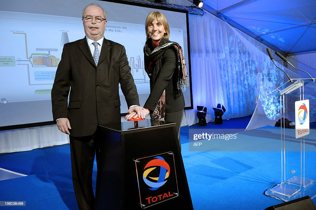French energy giant Total chief executive <a gi-track='captionPersonalityLinkClicked' href=/galleries/search?phrase=Christophe+de+Margerie&family=editorial&specificpeople=2624113 ng-click='$event.stopPropagation()'>Christophe de Margerie</a> and French junior minister for ecology and sustainable development Valerie Letard push a buzzer to symbolically inaugurate on January 11, 2010 the Total CO2 stockage site in Lacq, southwestern France. The event was shorten as two demonstrations were held by environment defenders protesting against the project and Total unionists calling for salary raises. The pilot project plans to stock 4.500 meter deep some 150.000 tons of CO2.