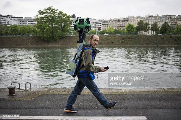 French engineer Luc Vincent in charge of all the imagery in Google's online maps walks holding the custommade panoramic camera which has made...