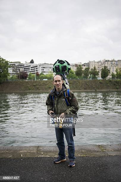 French engineer Luc Vincent in charge of all the imagery in Google's online maps poses holding the custommade panoramic camera which has made...