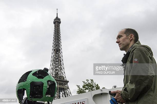 French engineer Luc Vincent in charge of all the imagery in Google's online maps poses next to the custommade panoramic camera which has made...