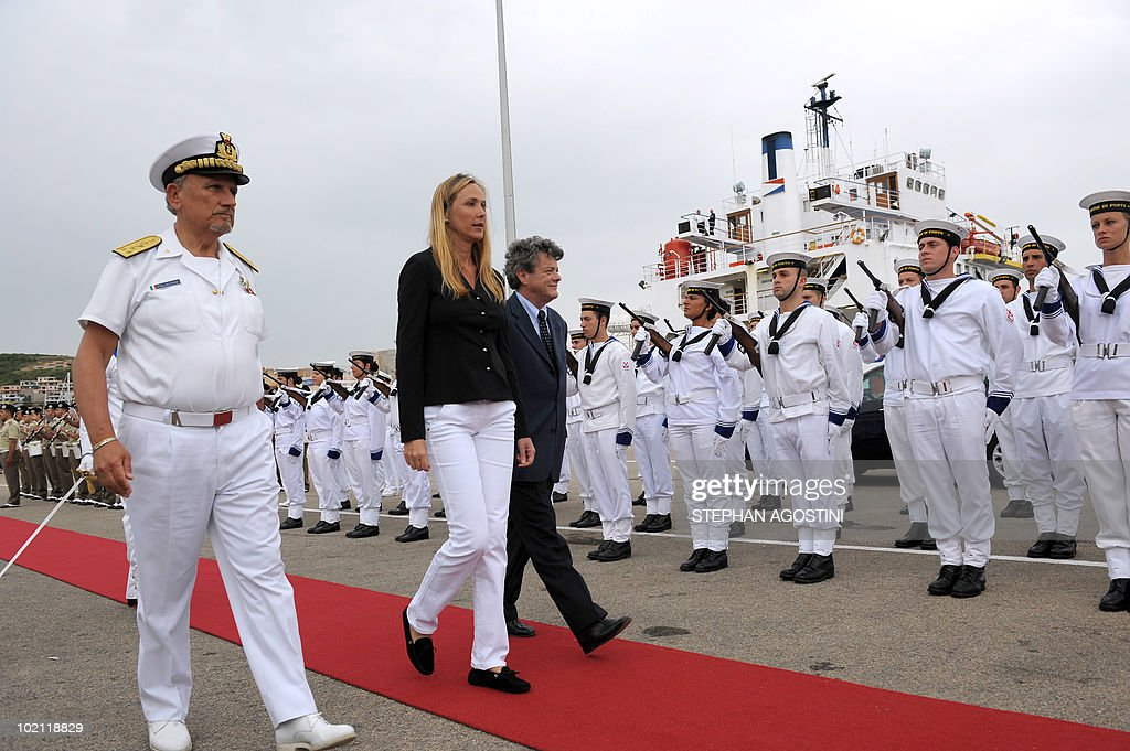 French Environment Minister Jean-Louis Borloo (3rdL) and his Italian counterpart Stefania Prestigiacomo (2ndL) review troops on June 15, 2010 at Palau on the Italian Mediterranean island of Sardaigna. Borloo and Prestigiacomo are due to ask the UN to forbid the transit of ships carrying hazardous material in the mouths of Bonifacio.