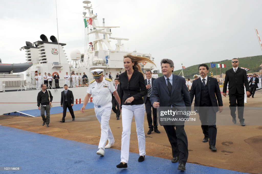 French Environment Minister Jean-Louis Borloo (R) and his Italian counterpart Stefania Prestigiacomo (L) walk on a dock on June 15, 2010 at the Palau's harbor on the Italian Mediterranean island of Sardaigna. Borloo and Prestigiacomo are due to ask the UN to forbid the transit of ships carrying hazardous material in the mouths of Bonifacio.