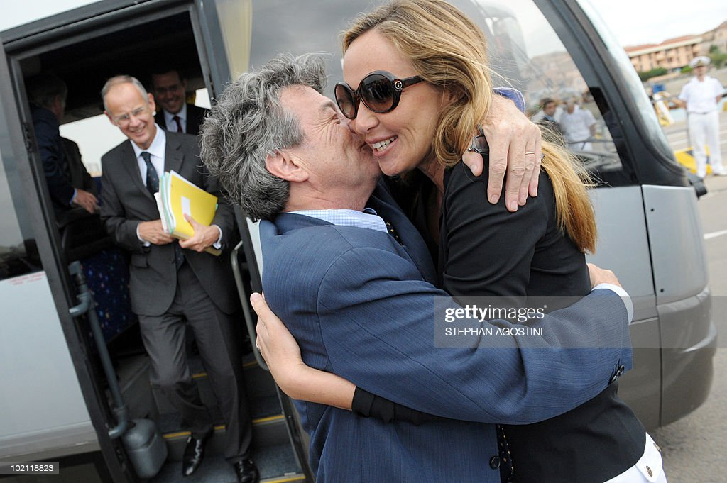 French Environment Minister Jean-Louis Borloo (L) kisses his Italian counterpart Stefania Prestigiacomo (R) on June 15, 2010 at Palau on the Italian Mediterranean island of Sardaigna. Borloo and Prestigiacomo are due to ask the UN to forbid the transit of ships carrying hazardous material in the mouths of Bonifacio.