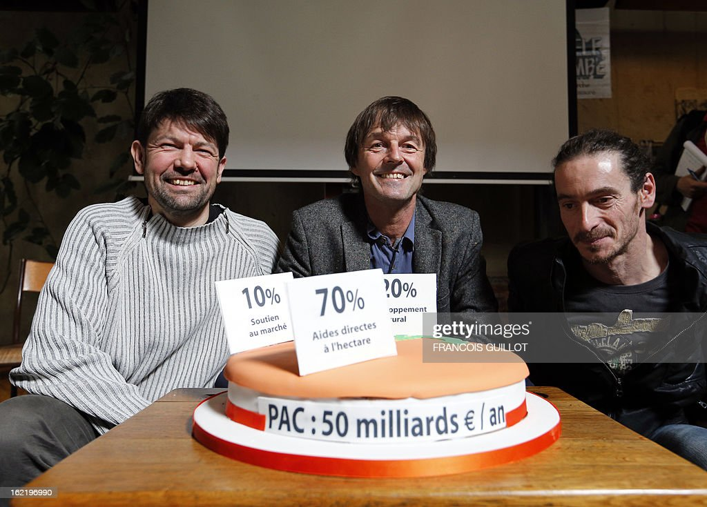 French environmental activist Nicolas Hulot (C) next to French grain farmer Quentin Delachapelle (L) and French Farmer Christophe Pontet (R) gives a press conference during the presentation of the citizen movement 'I field good', on February 20, 2013 in Paris.