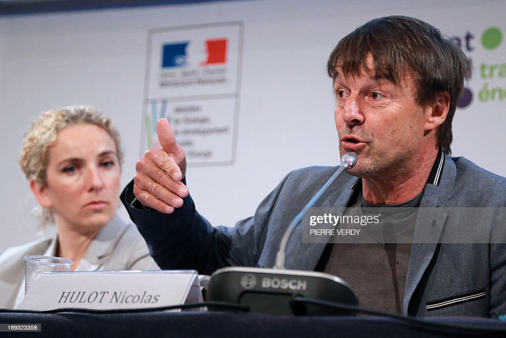 French environmental campaigner Nicolas Hulot (R) speaks alongside the French Minister of the Environment Delphine Batho during the start of a meeting by the government committee responsable for the national debate on energy transition and energy sources, in Paris, on May 23, 2013. Nicolas Hulot said that succumbing to the 'temptation' of extracting shale gas and not reducing the proportion of nuclear energy in overall energy output would be 'suicidal'.