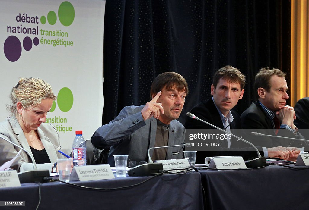 French environmental campaigner Nicolas Hulot (C) speaks alongside the French Minister of the Environment Delphine Batho (L) during the start of a meeting by the government committee responsable for the national debate on energy transition and energy sources, in Paris, on May 23, 2013. Nicolas Hulot said that succumbing to the 'temptation' of extracting shale gas and not reducing the proportion of nuclear energy in overall energy output would be 'suicidal'.
