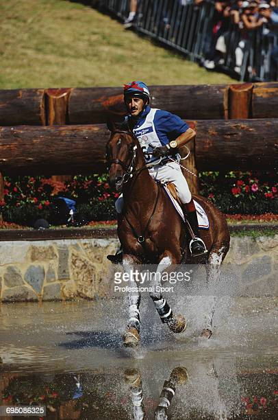 French equestrian JeanLuc Force competes on Crocus Jacob for the France team to finish in fourth place in the Team eventing equestrian event at the...