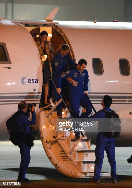 French ESA astronaut Thomas Pesquet leaves the plane at Cologne/Bonn airport early on June 3 after his arrival in Germany at the the ESA training...