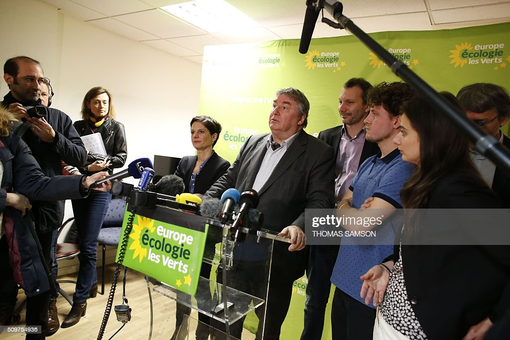 French Europe Ecologie Les Verts (EELV) green party member and senator Jean Desessard flanked by EELV party member Sandrine Rousseau (L), new leader David Cormand (4R), and party's members Julien Bayou (3R), Marine Tondelier (2R), and Jacques Boutault, mayor of the 2nd district of Paris (R), speaks on February 12, 2016 in Paris during a press conference. French President Francois Hollande reshuffled his cabinet on February 11, 2016, naming Jean-Marc Ayrault foreign minister and adding several ecologists to government as he seeks to widen his political base ahead of a presidential poll in 2017. AFP PHOTO / THOMAS SAMSON / AFP / THOMAS SAMSON