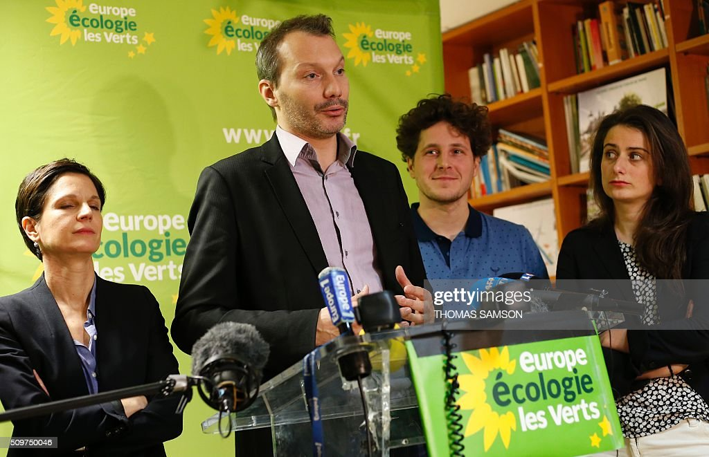 French Europe Ecologie Les Verts (EELV) green party new national secretary David Cormand, flanked by spokesperson Sandrine Rousseau (L), and party's members Julien Bayou (2R), Marine Tondelier (R), speaks on February 12, 2016 in Paris during a press conference. Cormand replaces Emmanuelle Cosse, named Housing minister by French President Francois Hollande. Hollande reshuffled his cabinet on February 11, 2016, naming Jean-Marc Ayrault foreign minister and adding several ecologists to government as he seeks to widen his political base ahead of a presidential poll in 2017. AFP PHOTO / THOMAS SAMSON / AFP / THOMAS SAMSON