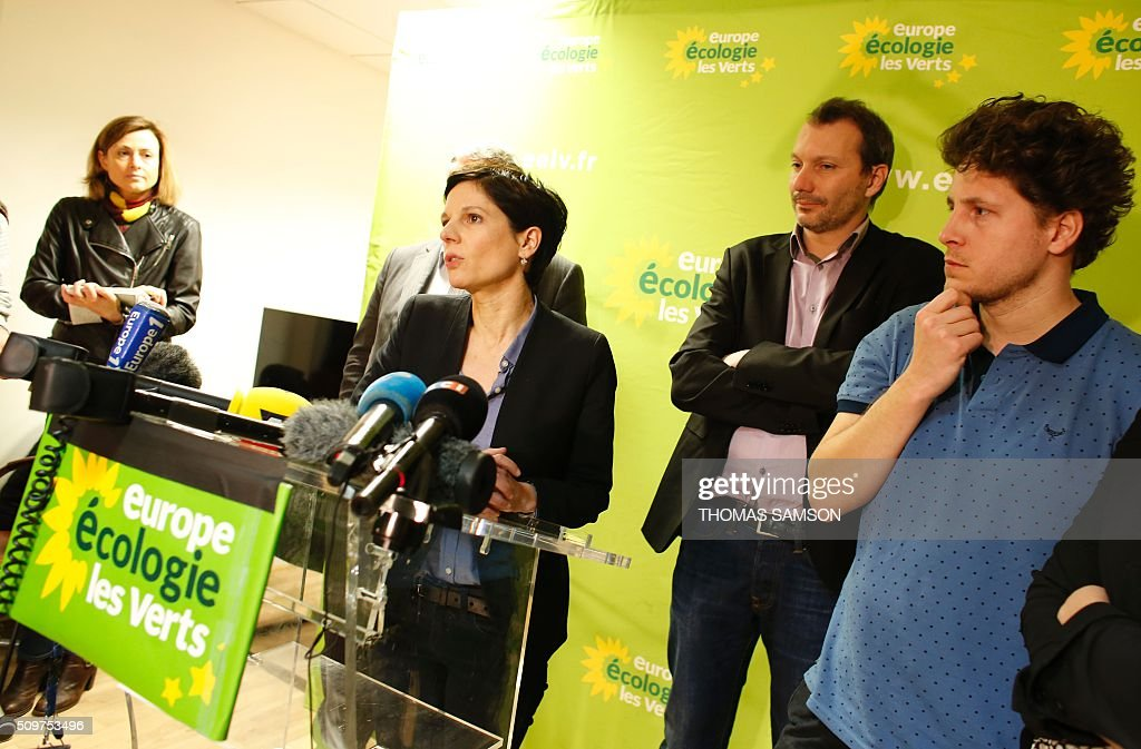 French Europe Ecologie Les Verts (EELV) green party spokesperson Sandrine Rousseau, flanked by EELV new leader David Cormand (2R), and party member Julien Bayou (R) speaks on February 12, 2016 in Paris during a press conference. Cormand replaced Emmanuelle Cosse, named Housing minister by French President Francois Hollande. Hollande reshuffled his cabinet on February 11, 2016, naming Jean-Marc Ayrault foreign minister and adding several ecologists to government as he seeks to widen his political base ahead of a presidential poll in 2017. AFP PHOTO / THOMAS SAMSON / AFP / THOMAS SAMSON