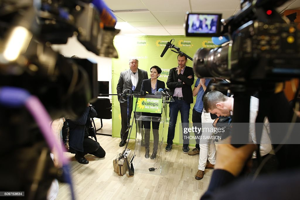 French Europe Ecologie Les Verts (EELV) green party spokesperson Sandrine Rousseau, flanked by EELV new leader David Cormand (R), and party member and senator Jean Desessard (L), speaks on February 12, 2016 in Paris during a press conference. Cormand replaced Emmanuelle Cosse, named Housing minister by French President Francois Hollande. Hollande reshuffled his cabinet on February 11, 2016, naming Jean-Marc Ayrault foreign minister and adding several ecologists to government as he seeks to widen his political base ahead of a presidential poll in 2017. AFP PHOTO / THOMAS SAMSON / AFP / THOMAS SAMSON