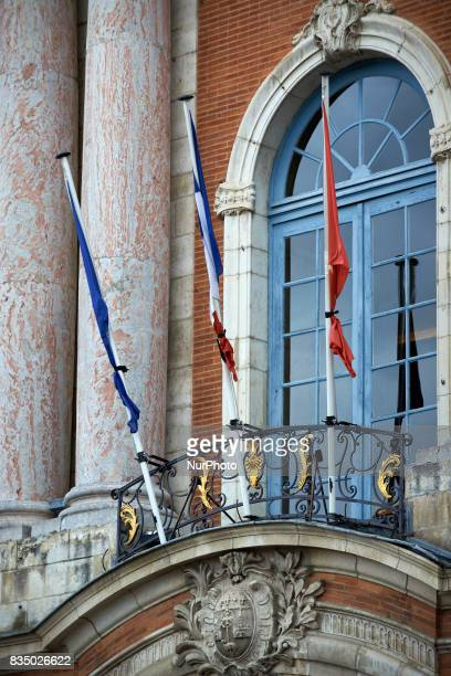 French European and Occitan flags are seen halfmast on the cityhall of Toulouse the Capitole in the aftermath of the Barcelona attacks Toulouse...