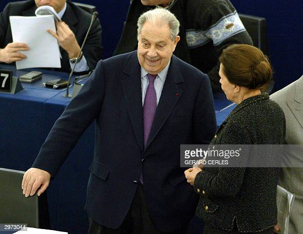 French European deputies Charles Pasqua and Marie Francoise Garaud chat during 12 February 2004 European Parliament session in Strasbourg AFP PHOTO...
