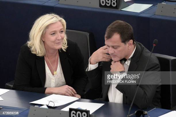 French European Parliament member and leader of the farright political party Front National Marine Le Pen speaks to FN vicepresident Louis Alliot...