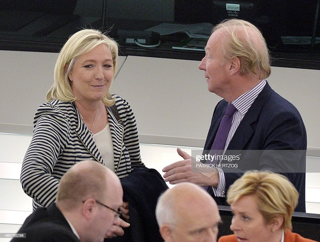 French European Parliament members Marine Le Pen (L) and Brice Hortefeux take part in a voting session at the European Parliament in Strasbourg, eastern France, on March 10, 2015. The European Parliament announced Monday that it had alerted anti-fraud investigators to possible financial irregularities committed by France's far-right National Front (FN) party, head by Marine Le Pen, over salaries paid to EU parliamentary assistants.