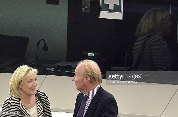 French European Parliament members Marine Le Pen and Brice Hortefeux take part in a voting session at the European Parliament in Strasbourg eastern...