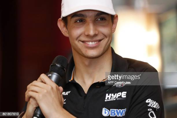 French F1 driver Esteban Ocon listens during a press conference on June 27 2017 at the automobile club in Paris to present the 2018 Formula 1 French...