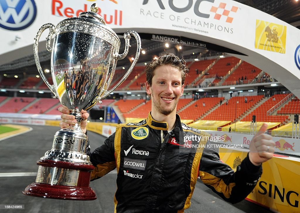 French F1 driver Romain Grosjean celebrates with the trophy after winning the Race of Champions (ROC) at Rajamangala Stadium in Bangkok on December 16, 2012. The Race of Champions (ROC) will take place in Thailand between December 14 and 16 and brings together heavyweights from all motor racing disciplines in the same type of car.
