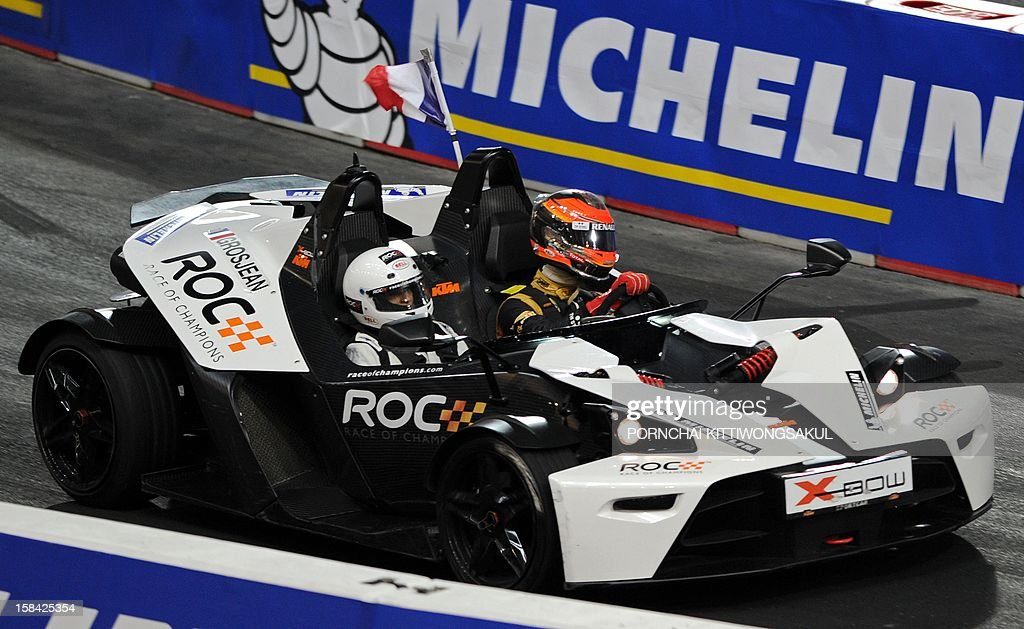 French F1 driver Romain Grosjean (R) competes in the Race of Champions (ROC) at Rajamangala Stadium in Bangkok on December 16, 2012. The Race of Champions (ROC) brings together heavyweights from all motor racing disciplines in the same type of car.