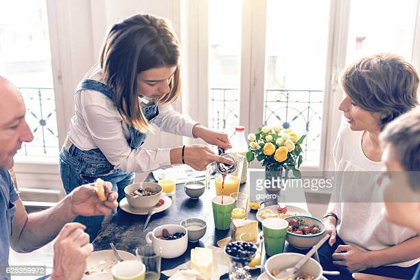 french family having breakfast together in appartment